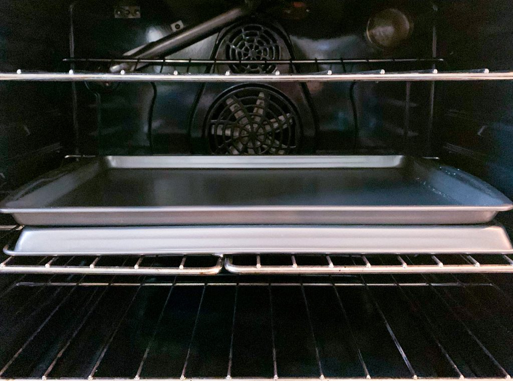 Photo of how baking tray is arranged on the middle rack of an oven